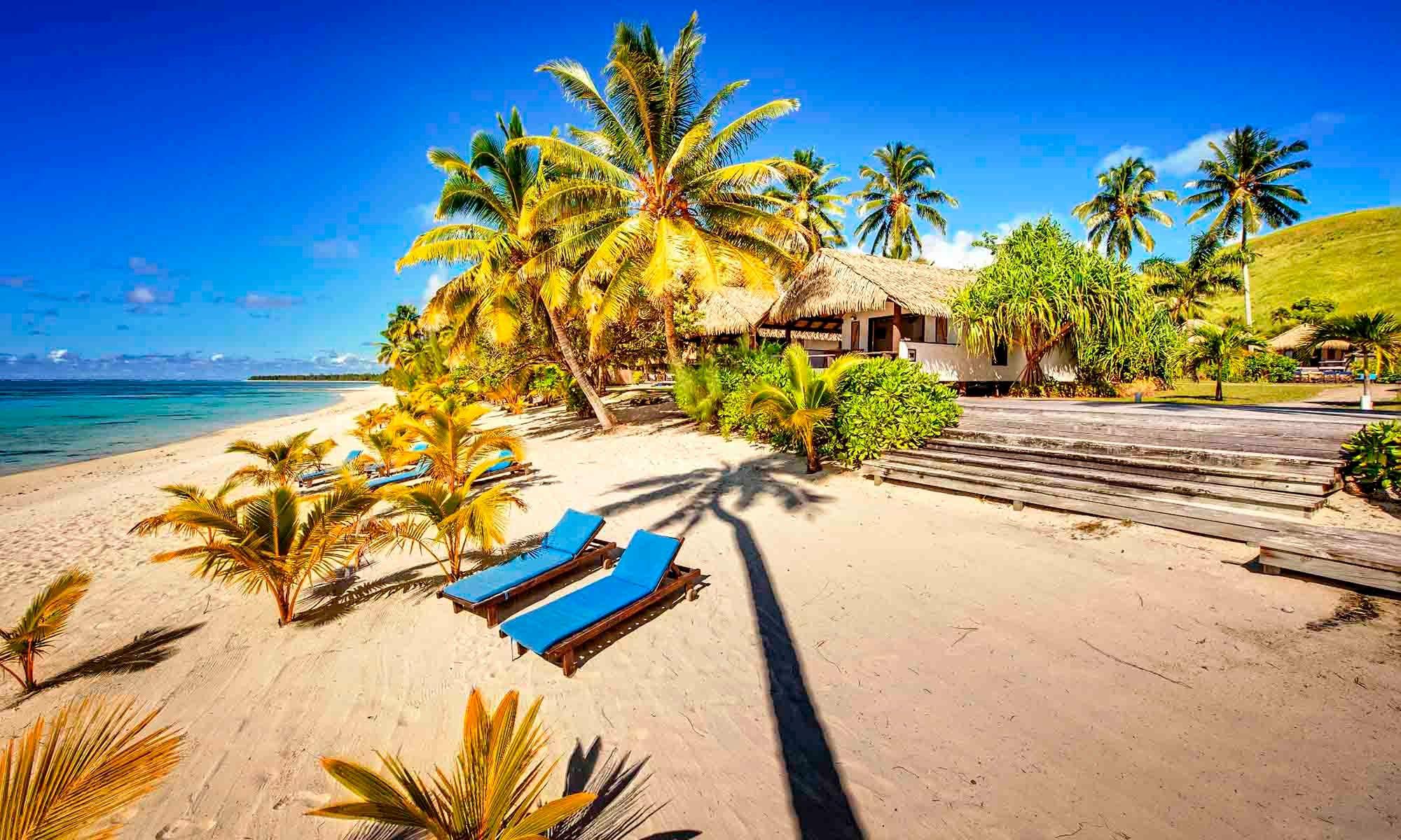 Tamanu beach resort cook islands blue beach chairs