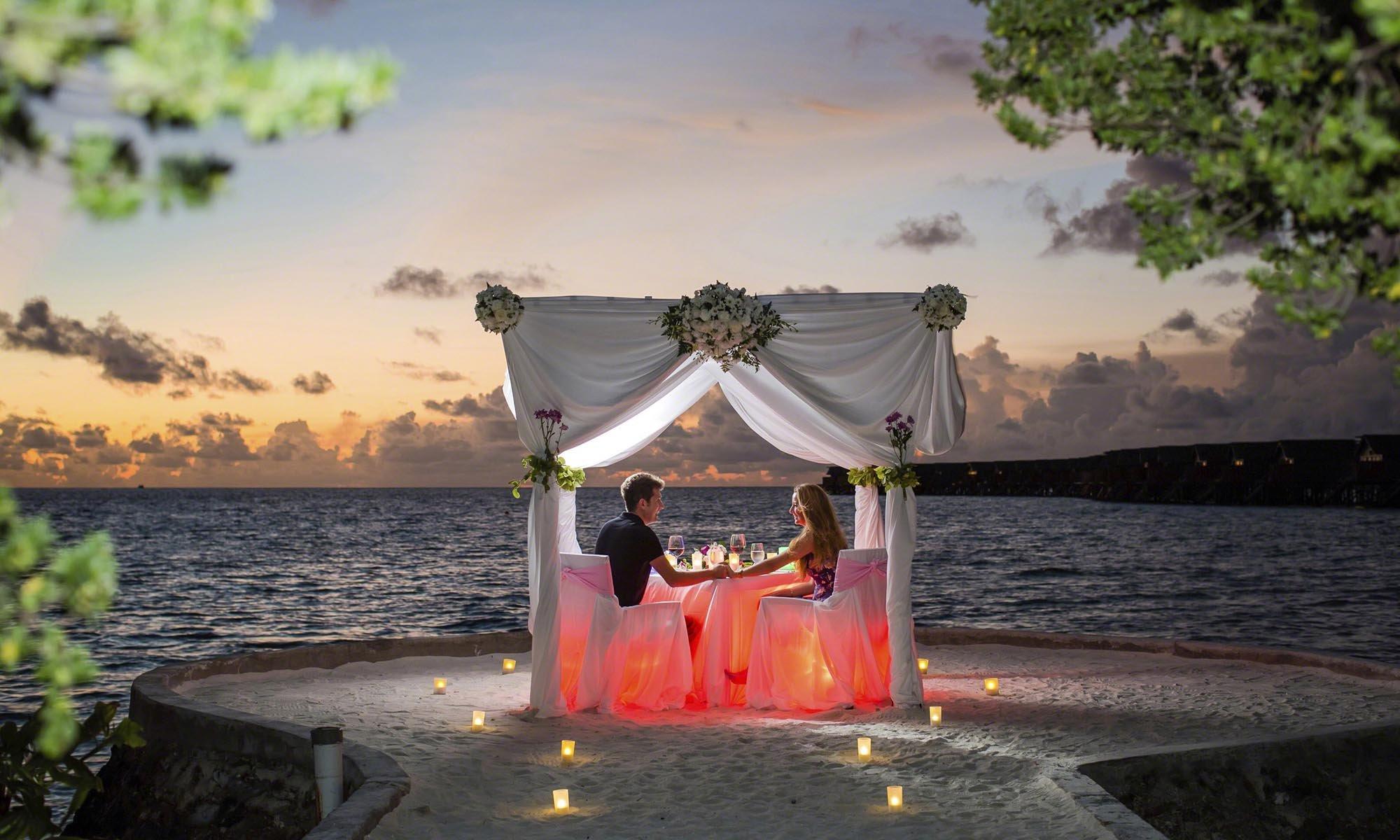 romantic private dinner on beach in maldives six senses