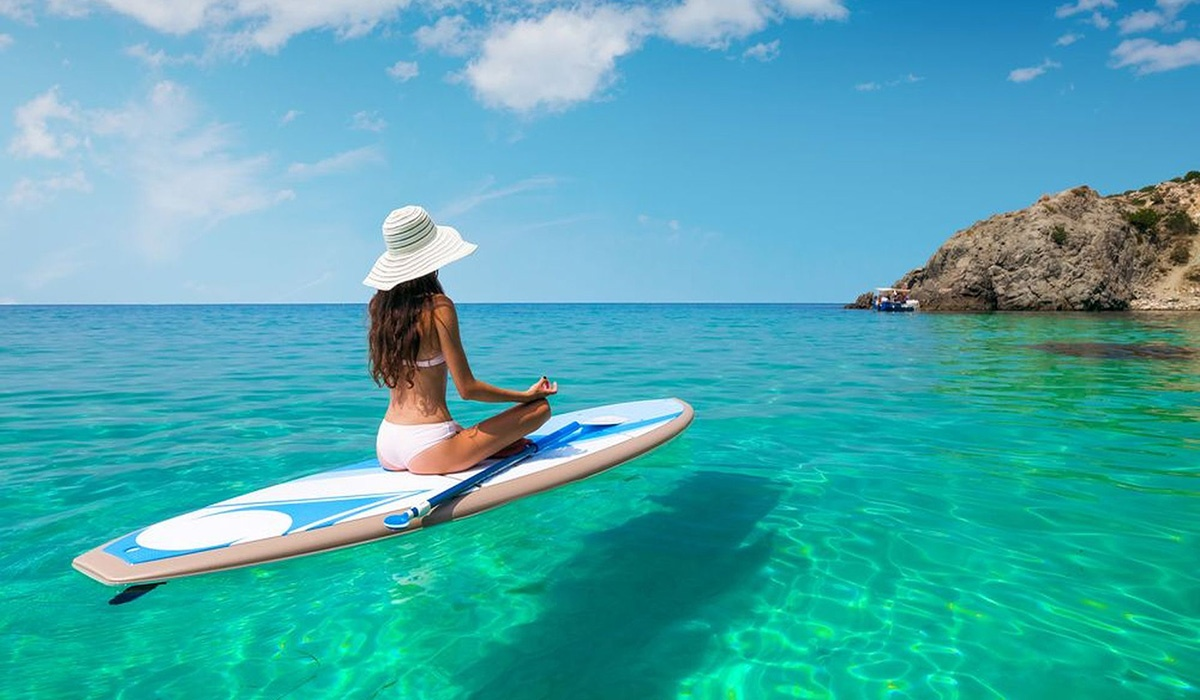 Girl on paddle board in tropical waters