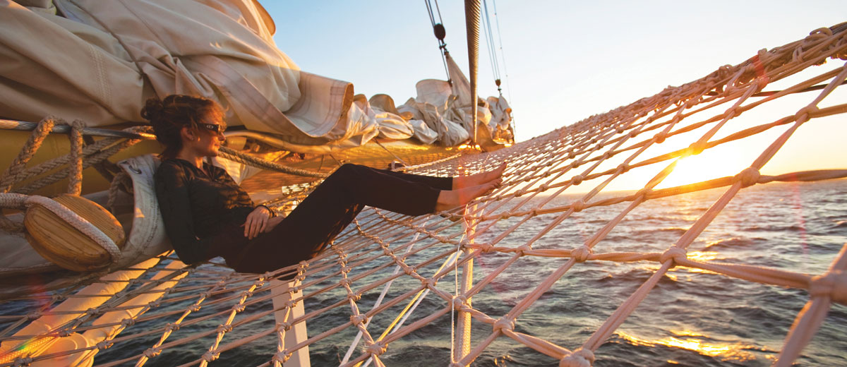 girl in net of ship at sea