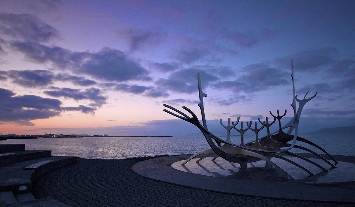 Sun Voyager (Icelandic: Sólfar) is a sculpture by Jón Gunnar Árnason purple sunset