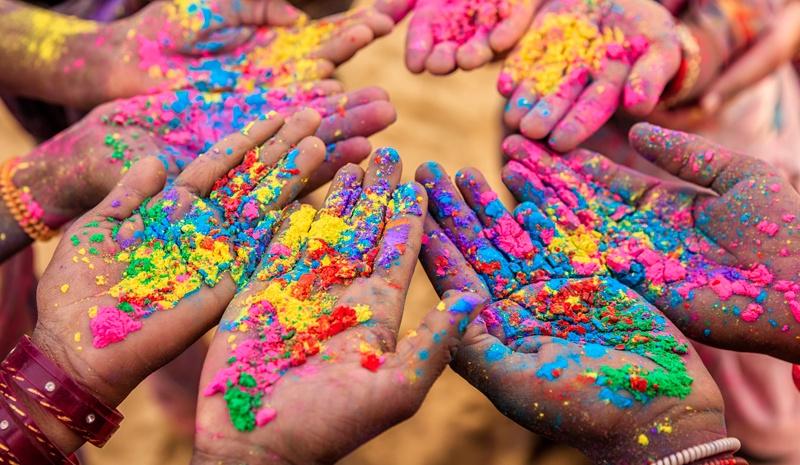India Holi Festival hands holding colourful gulal powder